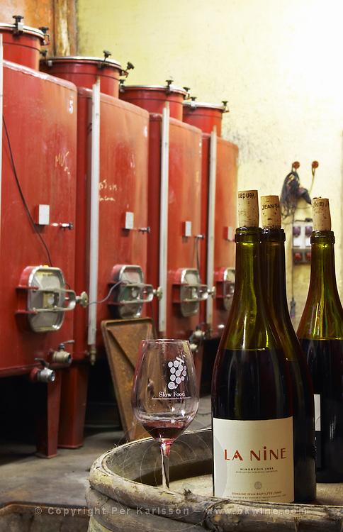 La Nine. Glass with Slow Food. Domaine Jean Baptiste Senat. In Trausse. Minervois. Languedoc. Painted steel vats. France. Europe. Bottle. Wine glass.