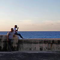 Central America, Cuba, Havana.  Cubans on the Malecon, Havana.