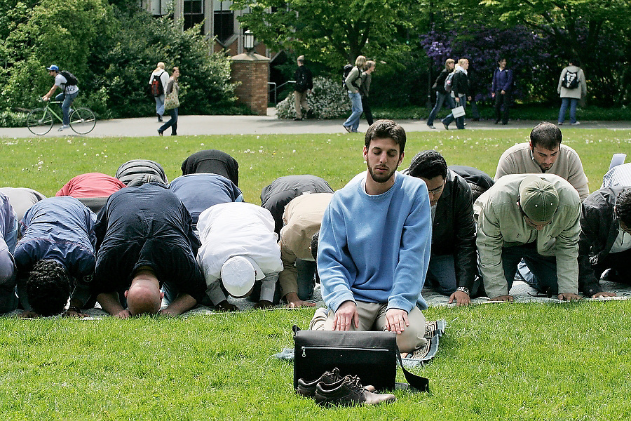 Hassan Hatem, President of the Muslim Students' Association at the University of Washington in Seattle, leads the noon prayer (Zhur), one of five daily prayers prescribed by the Qur'an, on May 5, 2007. Hatem chose to conduct the prayer outside to raise public awareness of Muslim culture and faith.