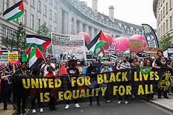 London, UK. 26th June, 2021. Activists from United for Black Lives join thousands of people attending a United Against The Tories national demonstration organised by the People's Assembly Against Austerity in protest against the policies of Prime Minister Boris Johnson's Conservative government. The demonstration contained blocs from organisations and groups including Palestine Solidarity Campaign, Stand Up To Racism, Stop The War Coalition, Extinction Rebellion, Kill The Bill and Black Lives Matter as well as from trade unions Unite and the CWU.
