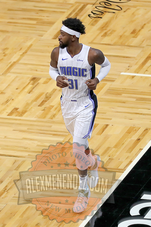 ORLANDO, FL - FEBRUARY 17:   Terrence Ross #31 of the Orlando Magic runs up the court against the New York Knicks at Amway Center on February 17, 2021 in Orlando, Florida. NOTE TO USER: User expressly acknowledges and agrees that, by downloading and or using this photograph, User is consenting to the terms and conditions of the Getty Images License Agreement. (Photo by Alex Menendez/Getty Images)*** Local Caption *** Terrence Ross