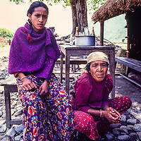 Nepali women relax outside their teahouse in the Pokhara Valley, Nepal.