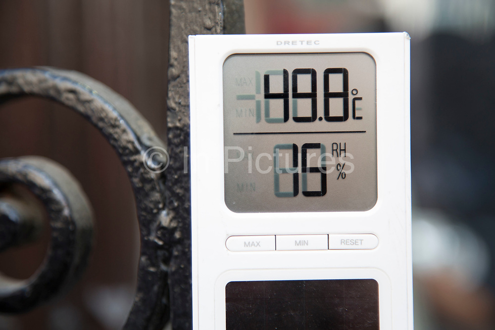 """London, UK. Wednesday 4th September 2013. Thermometer read the temperature as 49.8 degrees C. Urgent action in planned to """"cover up"""" the Walkie Talkie skyscraper in the City after sunlight reflected from the building melted a car on the streets below. Temperatures have been measured in excess of 50 degrees C, and as much as 70 degrees at it's peak. The 525ft building has been renamed the """"Walkie Scorchie"""" after its distinctive concave surfaces reflected a dazzling beam of light which has caused extensive damage to nearby buildings."""
