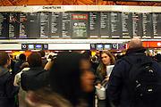 Departure board at Victoria train station, London.