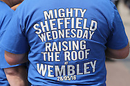 """a Sheffield Wednesday fan wearing """"Mighty Sheffield Wednesday Raising The Roof at Wembley 28/05/16"""" t-shirt outside Wembley Stadium before k/o. Skybet football league Championship play off final match, Hull city v Sheffield Wednesday at Wembley Stadium in London on Saturday 28th May 2016.<br /> pic by John Patrick Fletcher, Andrew Orchard sports photography."""