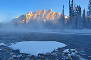 Castle Mountain of the Canadian Rocky Mountains and the Bow River at sunrise. , Banff National Park, Alberta, Canada