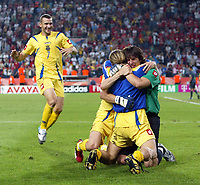 Photo: Chris Ratcliffe.<br /> Switzerland v Ukraine. 2nd Round, FIFA World Cup 2006. 26/06/2006.<br /> Andriy Shevchenko of Ukraine (top) celebrates winning with team mates.
