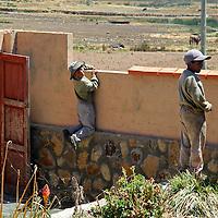 South America, Bolivia, Pariti. Local boys of Pariti Island on Lake Titicaca.