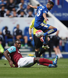 Michail Antonio of West Ham United (L) tackles Riyad Mahrez of Leicester City - Mandatory by-line: Jack Phillips/JMP - 17/04/2016 - FOOTBALL - King Power Stadium - Leicester, England - Leicester City v West Ham United - Barclays Premier League
