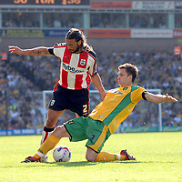 Photo: Ashley Pickering.<br /> Norwich City v Southampton. Coca Cola Championship. 28/04/2007.<br /> Adam Drury of Norwich (R) tackles Alexander Bialkowski of Southampton