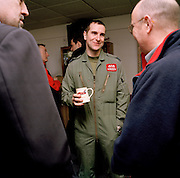 Pilot of the Red Arrows, Britain's RAF aerobatic team smiles politely during conversations with corporate guests.