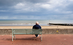 Portobello, Scotland, UK. 28 March, 2020. On the first weekend of the coronavirus lockdown the public were outdoors exercising and maintaining social distancing along Portobello beachfront promenade. Pictured; Solitary man on bench practicing social distancing . Iain Masterton/Alamy Live News