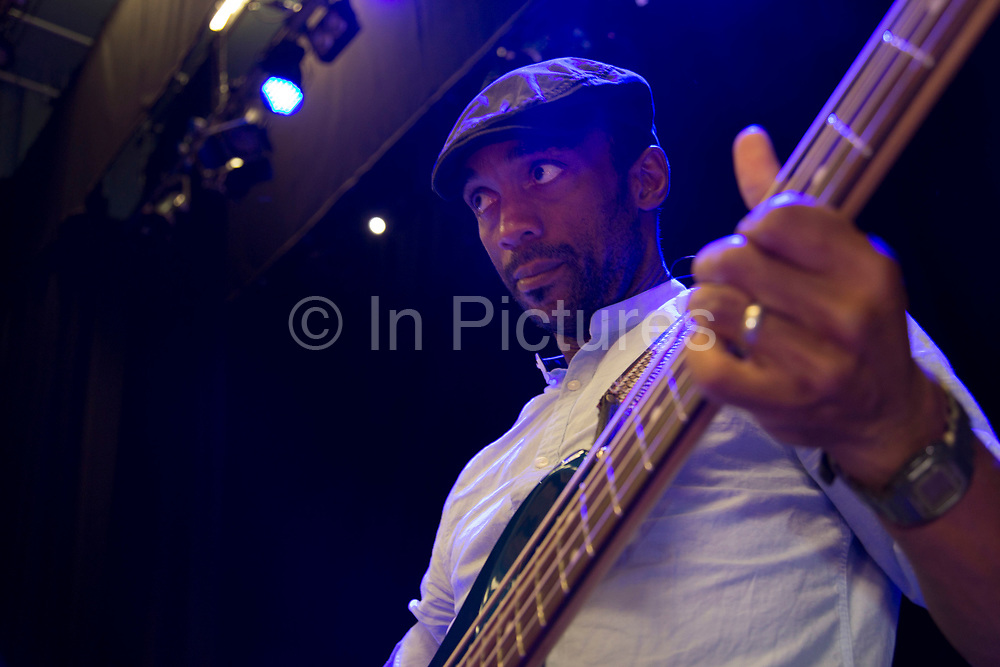 Bass player Bernard Georges during soundcheck. Throwing Muses at the Islington Assembly Hall, London, UK. Throwing Muses are an alternative rock band founded in 1980. The group was originally fronted by two lead singers, Kristin Hersh, and Tanya Donelly. Known for performing music with shifting tempos, creative chord progressions, unorthodox song structures, and surreal lyrics, the group was set apart from other contemporary acts by Hersh's stark, writing style, David Narcizo's unusual drumming techniques almost totally without cymbals and Bernard Georges' driving baselines.