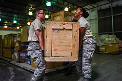 U.S. Air Force Airman Nicholas McKendall, left, a C-130 mobility readiness spares package apprentice with the 1st Special Operations Logistics Readiness Squadron, and U.S. Air Force Airman 1st Class Iyana Wells, a C-130 MRSP journeyman with the 1st SOLRS, carry an aircraft part to place on a pallet at Hurlburt Field, Florida, July, 12, 2018. Air Commandos with MRSP support maintenance squadrons by storing and supplying aircraft parts including propellers, tires and radar parts. (U.S. Air Force photo by Airman 1st Class Dennis Spain)