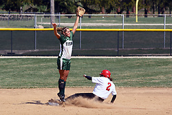 05 April 2008: Kari Peterson slides into 2nd while Allison Ward watches the ball go too high. The Carthage College Lady Reds lost the first game of this double header to the Titans of Illinois Wesleyan 4-1 at Illinois Wesleyan in Bloomington, IL