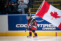 KELOWNA, CANADA - NOVEMBER 9: Cooper Vogt skates with the Canadian flag during opening ceremonies   on November 9, 2015 during game 1 of the Canada Russia Super Series at Prospera Place in Kelowna, British Columbia, Canada.  (Photo by Marissa Baecker/Western Hockey League)  *** Local Caption *** Cooper Vogt;