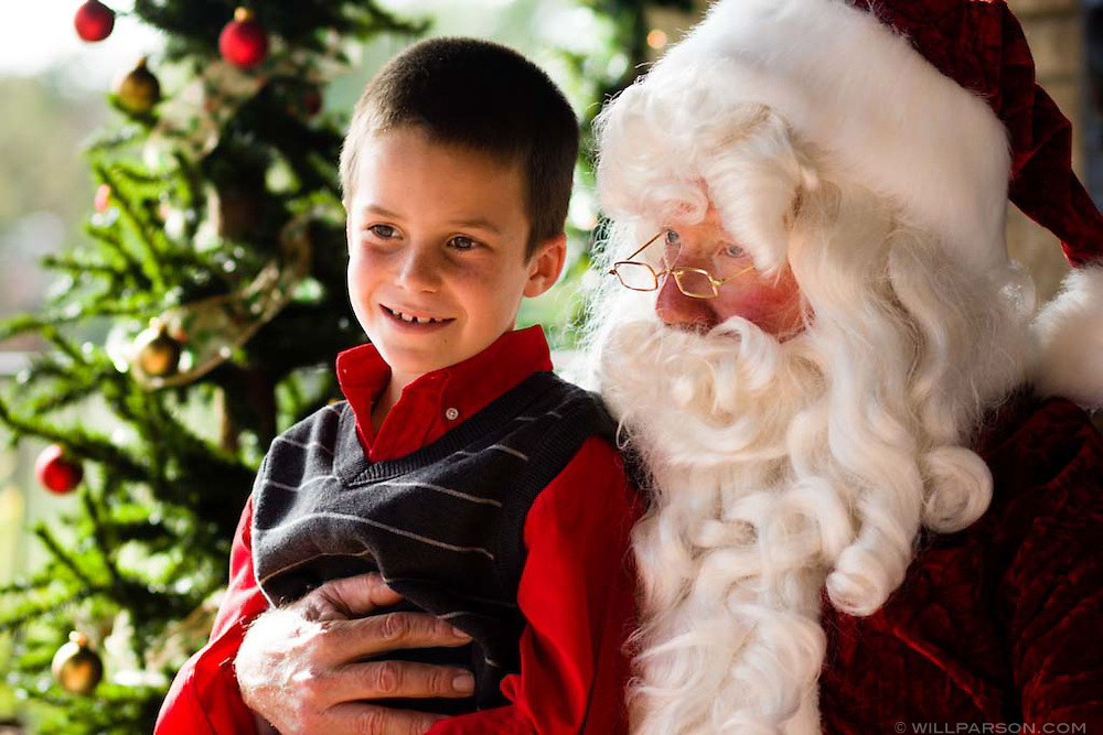 Jamie Licosati, 8, sits on Santa's lap during the Santa Brunch at the Rancho Santa Fe Golf Club on December 14, 2008.