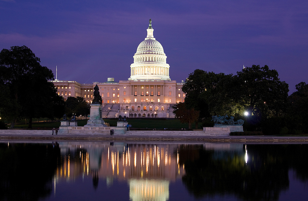Evening view and reflections of the US Capitol, among the most architecturally impressive and symbolically important buildings in the world. The Senate and the House of Representatives have met here for more than two centuries. Begun in 1793, the Capitol has been built, burnt, rebuilt, extended, and restored.