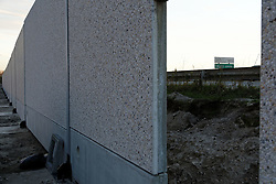 """The anti-refugee wall is almost completed in Calais, northern France, November 2, 2016. The dismantlement of the """"Jungle"""" camp that once housed up to 10,000 migrants, most of whom have been relocated around France, was completed on November 1, 2016 during the night but the government must still resolve the situation of the unaccompanied minors. The minors have been awaiting news of their transfer to Britain or alternative housing in France, with their fate a source of enduring tension between London and Paris.Photo by Aimee Arys/ABACAPRESS.COM"""