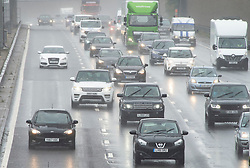 © Licensed to London News Pictures. 19/07/2019.<br /> Dartford,UK.Clockwise traffic. Frantic Friday Getaway on the M25 near Dartford in Kent. Rain and heavy traffic this afternoon as the the schools break up for the summer holiday.  Photo credit: Grant Falvey/LNP