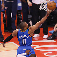 11 May 2014: Oklahoma City Thunder guard Russell Westbrook (0) goes for the layup past Los Angeles Clippers guard Chris Paul (3) during the Los Angeles Clippers 101-99 victory over the Oklahoma City Thunder, during Game Four of the Western Conference Semifinals of the NBA Playoffs, at the Staples Center, Los Angeles, California, USA.