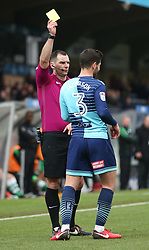 Wycombe Wanderers' Joe Jacobson is shown the yellow card during the Emirates FA Cup, second round match at Adams Park, Wycombe.