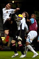 Photo: Ed Godden.<br /> West Ham United v Manchester United. The Barclays Premiership. 17/12/2006. Man Utd's Nemanja Vidic (R), misses the ball.