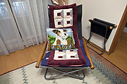 chair with embroidery cushion in residential house