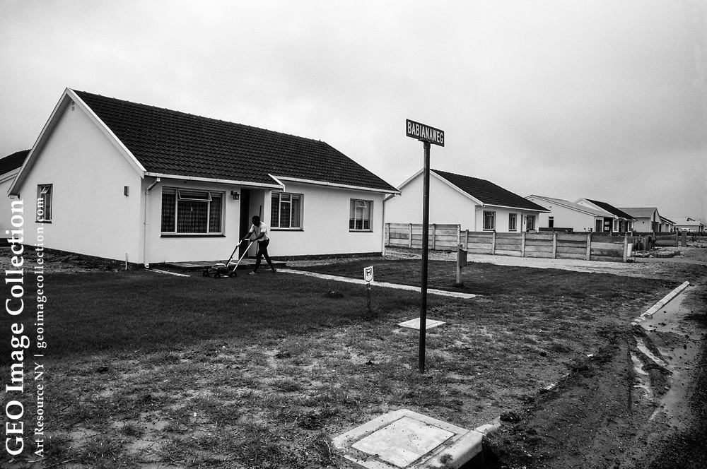 Many racially mixed South Africans live in government-built housing.