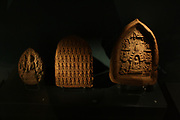 Terracotta votive plaques. Akshobhya Buddha, Hmawza, Burma, AD800-1000. Scenes from, the Buddha's life, Pagan, Burma, 1000-1300.  Multiple Buddha's in rows, Burma, 1000-1300.