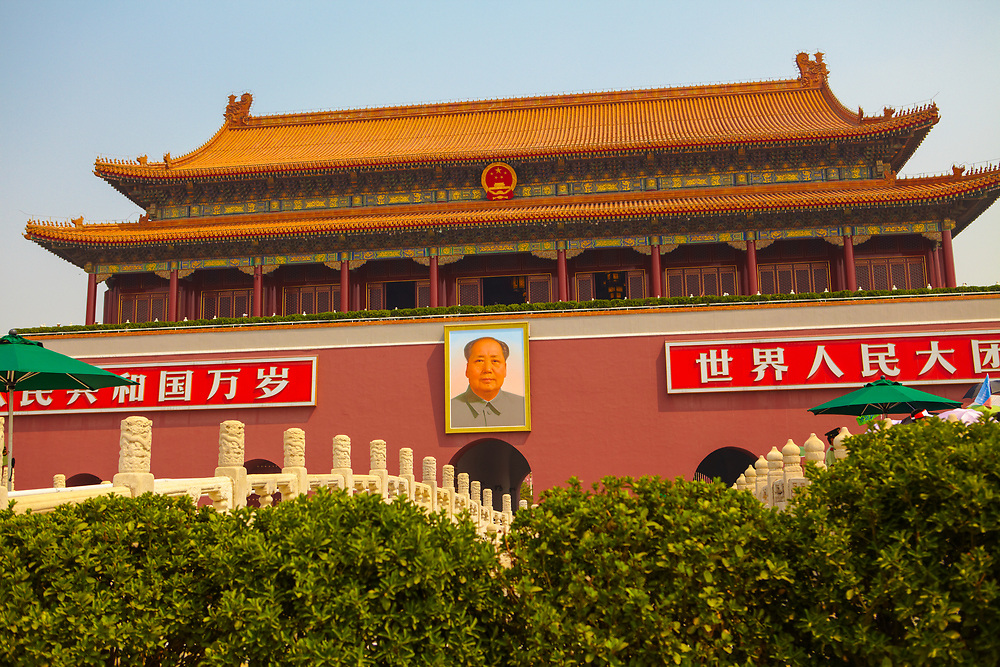 Bridge entrance to Forbidden City with shrubs in the foreground, Beijing, China