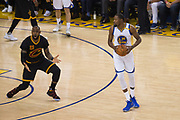Cleveland Cavaliers forward LeBron James (23) reacts to a foul called while defending Golden State Warriors forward Kevin Durant (35) during Game 5 of the NBA Finals at Oracle Arena in Oakland, Calif., on June 12, 2017. (Stan Olszewski/Special to S.F. Examiner)