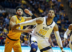 Nov 24, 2018; Morgantown, WV, USA; West Virginia Mountaineers forward Sagaba Konate (50) boxes out Valparaiso Crusaders guard Markus Golder (5) during the first half at WVU Coliseum. Mandatory Credit: Ben Queen-USA TODAY Sports