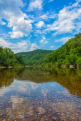 The Buffalo River, located in northern Arkansas, was the first National River to be designated in the United States. The Buffalo River is slightly more than 150 miles long. The Buffalo National River gets its start in national forest country, nearly within rock-throwing distance of the highest point in the Ozarks. Some floating takes place in the headwaters area (the 'Hailstone' trip from Dixon Road to Arkansas 21 is almost legendary among serious paddlers), but, for most, this is a good place to put on the hiking boots. A real treat is the Upper Buffalo Wilderness, a 14,200-acre tract managed by the Ozark National Forest and the Buffalo National River. Visitors to the area can expect to see caves, bluffs, waterfalls, old cabin sites, natural springs and maybe even a local black bear.