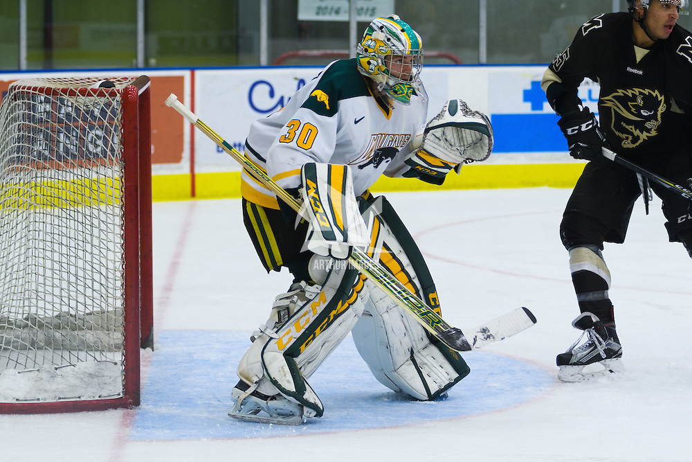 2nd year goalie Andy Desautels (30) of the Regina Cougars in action during the Men's Hockey Home Opener on October 21 at Co-operators arena. Credit: Arthur Ward/Arthur Images
