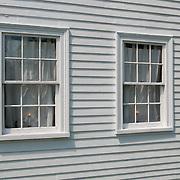 Windows in the Rev. Daniel Putnam House built in 1720 stands in North Reading, Massachusetts.