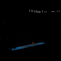 Tennis great Roger Federer volleys within the slither of light during an Australian Open practise session at Melbourne Park in Melbourne, Sunday, January 19, 2020.