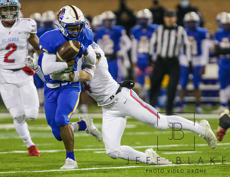 North Myrtle Beach Chiefs Nick Moss (13) fumbles as he is hit by AC Flora Falcons defensive back Boyce Bankhead (4) during the first half the state championship game at Benedict College.