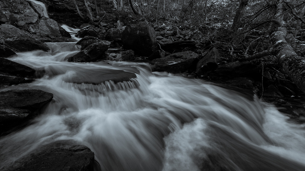 Mountain water flowing through Doane's Falls on a cold autumn evening.