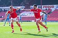 Alex Mowatt of Barnsley (27) scores a goal and celebrates with Cauley Woodrow of Barnsley (9) to make the score 1-0 during the EFL Sky Bet League 1 match between Barnsley and Coventry City at Oakwell, Barnsley, England on 30 March 2019.