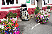 Dr Who Dalek model used as a waste bin, Aldbourne, Wiltshire, England