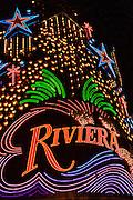 Neon light exterior of the Riviera casino and resort in Las Vegas, NV.