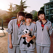 Liu Yu Peng,16 (left) with friends, is in high-school (equivalent of lower sixth) and is preparing for her mid-semester exam (the Chinese equivalent of A levels) She hopes to get the grades to go to the China Communication University - the most prestigious place in China to study media. Her father is a driving instructor and her mother, a clothes shop manager and she lives with them both in Beijing. Yu Peng says that many of her friends suffer from depression because of the pressures put on them. ..Its over thirty years (1978) since the Mao's Chinese government brought in the One Child Policy in a bid to control the world's biggest, growing population. It has been successful, in controlling growth, but has led to other problems. E.G. a gender in-balance with a projected 30 million to many boys babies; Labour shortages and a lack of care for the elderly.