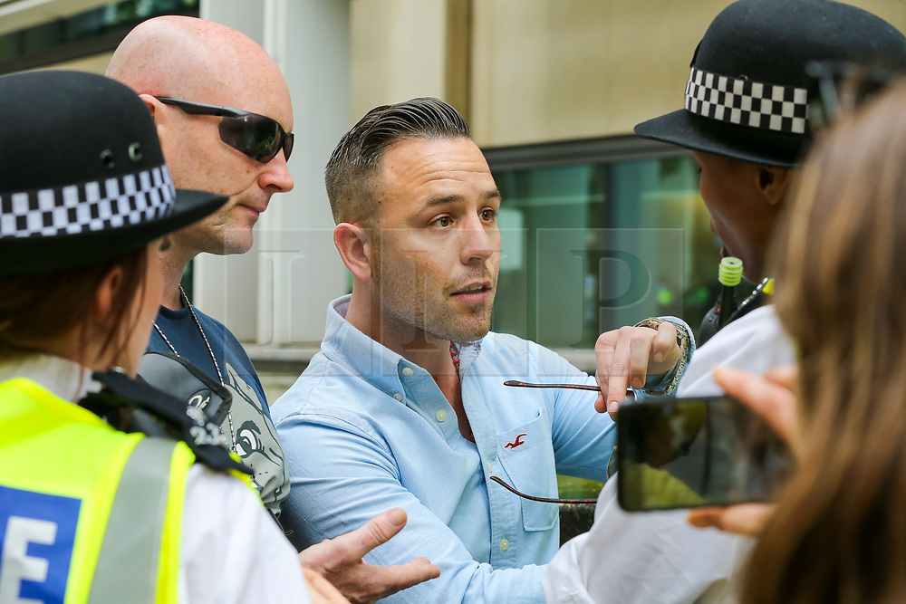 © Licensed to London News Pictures. 02/06/2019. London, UK. A police officer speaks with Danny Tommo (real name Daniel Thomas) an associate of Tommy Robinson. <br /> Protesters take part in the annual Al Quds day protest and march from Home Office to Whitehall in central London. Al-Quds Day, an annual day of protest decreed in 1979 by the late Iranian ruler Ayatollah Khomeini, is celebrated to express support for the Palestinian people and their resistance against Israeli occupation. A counter demonstration by Israel supporters takes place. Photo credit: Dinendra Haria/LNP