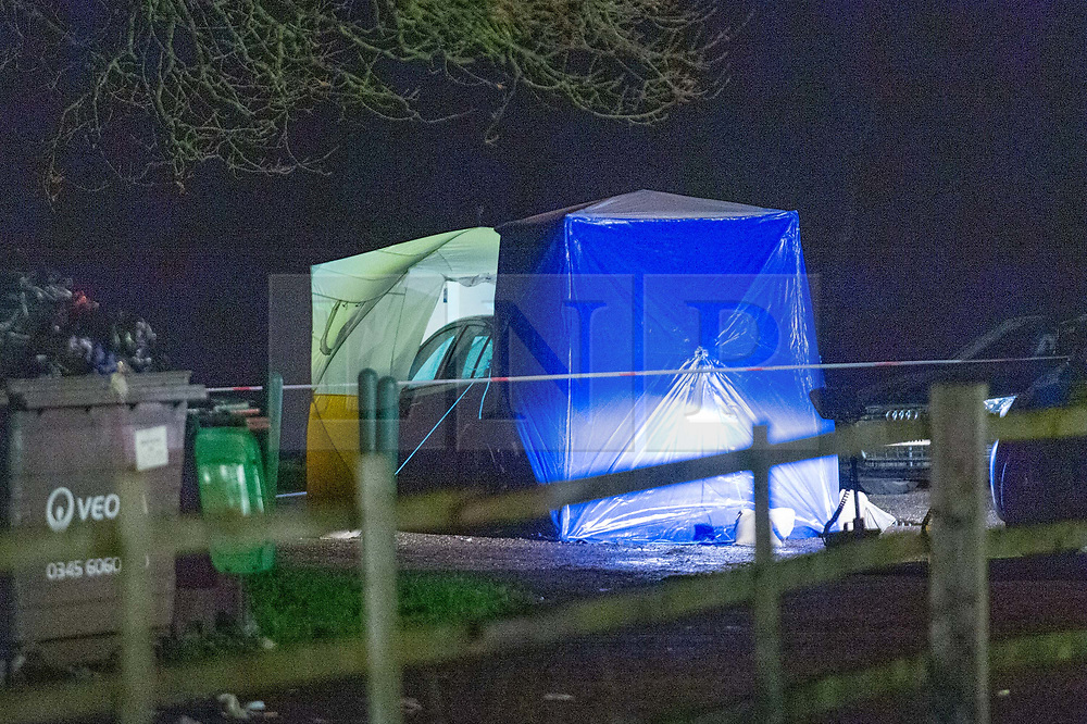 © Licensed to London News Pictures. 19/12/2019. London, UK. Police forensic tents are placed over a victim and vehicle in Scratchwood Park carpark after a man died of stab injuries. Police were called to Courtland Avenue, NW7, at 20:11GMT following a report of a fight in progress. Officers attended however no trace of any victim or suspects was found. At 20.27GMT, police were called by the London Ambulance Service to Barnet Bypass, near Scratchwood Park, to reports of a man, in his 20s, with stab injuries. Officers attended. The man was treated at the scene by paramedics before being taken to hospital. After a search of a car found at the scene, a man, in his 30s, was found inside a vehicle with stab wounds. Despite the efforts of emergency services, he was declared dead a short time later.. Photo credit: Peter Manning/LNP