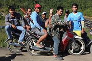 August 2012: Dayak hunters with motorbikes and shotguns get ready to go on a hunting spree. Belaga region, Sarawak, Borneo <br /> <br /> Sarawak's primary rainforests have been systematically logged over decades, threatening the sustainable lifestyle of its indigenous peoples who relied on nomadic hunter-gathering and rotational slash & burn cultivation of small areas of forest to survive. Now only a few areas of pristine rainforest remain; for the Dayaks and Penan this spells disaster, a rapidly disappearing way of life, forced re-settlement, many becoming wage-slaves. Large and medium size tree trunks have been sawn down and dragged out by bulldozers, leaving destruction in their midst, and for the most part a primary rainforest ecosystem beyond repair. Nowadays palm oil plantations and hydro-electric dam projects cover hundreds of thousands of hectares of what was the world's oldest rainforest ecosystem which had some of the highest rates of flora and fauna endemism, species found there and nowhere else on Earth, and this deforestation has done irreparable ecological damage to that region.