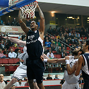 Efes Pilsen's Lawrence ROBERTS (L) and Besiktas's Cevher OZER (2ndR) during their Spor Toto Turkey Cup Basketball quarter final match Efes Pilsen between Besiktas at the Kadir Has Arena in Kayseri at Turkey on Wednesday, February, 09, 2011. Photo by TURKPIX