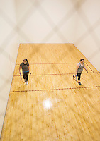 Hillary Stanley and Mikenzie Watson play a game of racquetball on the court at the Laconia Community Center on Wednesday afternoon.  (Karen Bobotas/for the Laconia Daily Sun)