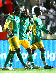 Vodacom Park, Bloemfontein. Bafana vs Ghana.151008. Bafana substitute Bernard Parker, centre gets a hug from teammate Benni McCarthy after he scored the winning goal. Left is Teko Modise. Picture: Etienne Rothbart.