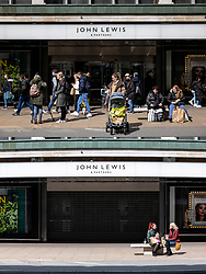 © Licensed to London News Pictures. 12/04/2021. London, UK. Paired images showing shoppers outside John Lewis on Oxford Street on Monday 12 April 2021 (TOP) after shops reopened, and the same location the day before, Sunday 11 April 2021 (BOTTOM), when shops were closed. Pubs, restaurants and non-essential shops reopened on Monday 12 April 2021 as England begins the second phase of 'unlocking' after months of lockdown. Photo credit: Rob Pinney/LNP